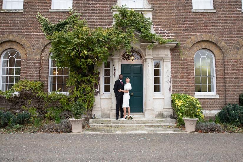 Bridal couple outside Morden Park House. Kirsten Duberly Photography. Weddings at Morden Park House
