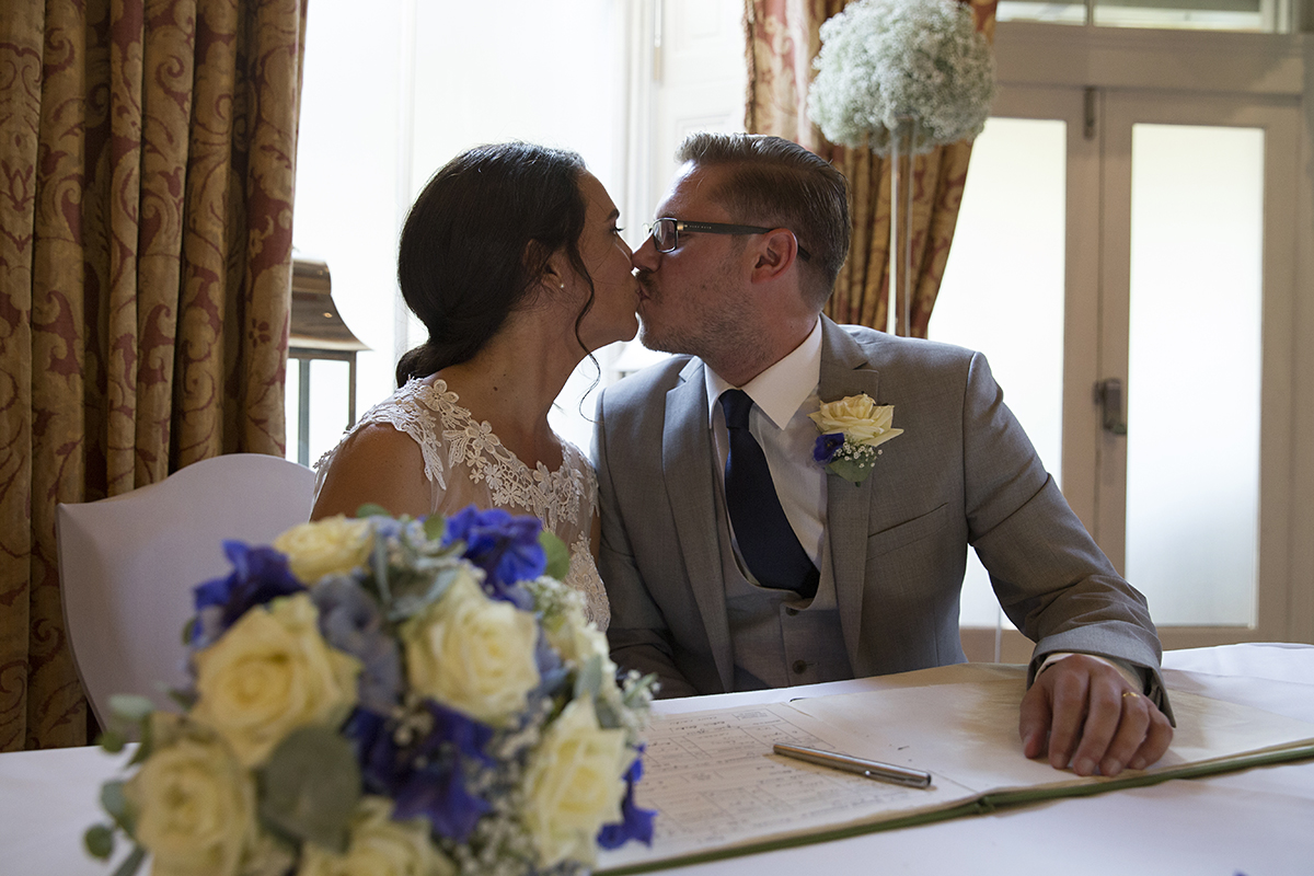 Bridal couple kiss. Kirsten Duberly Photography. Wedding photography Ashtead and Woking