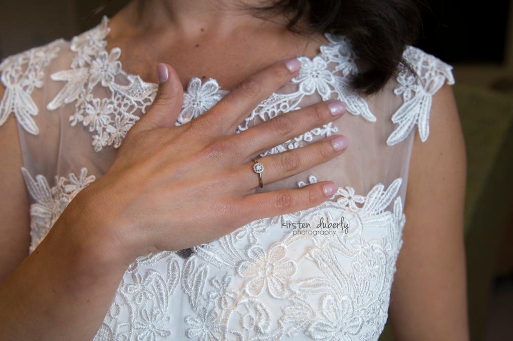 Bride's engagement ring and lace dress. Cobham Surrey