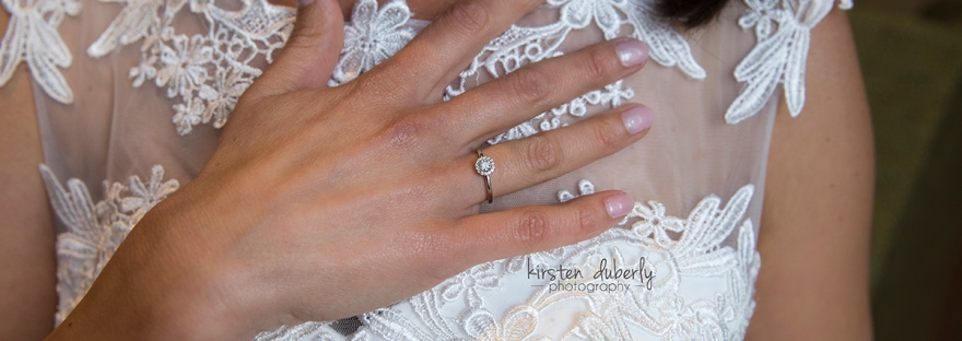 Bride's engagement ring and lace dress. Cobham Surrey